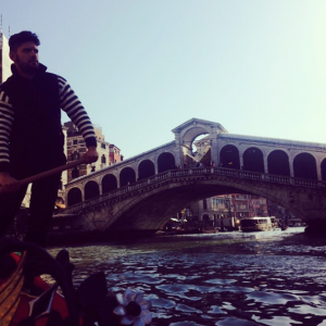 Sebastiano steering me under the Rialto Bridge.